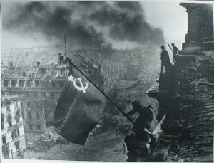 1945 – its the communist Russian troops raising the flag over the  Reichstag in Berlin